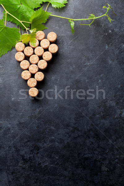 Wine corks grape shape and vine Stock photo © karandaev