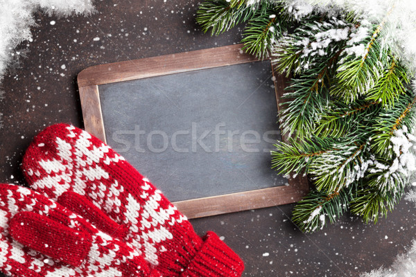 Christmas fir tree, mittens and chalkboard for your greetings Stock photo © karandaev