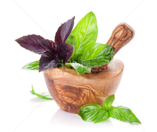 Garden basil herbs in mortar Stock photo © karandaev