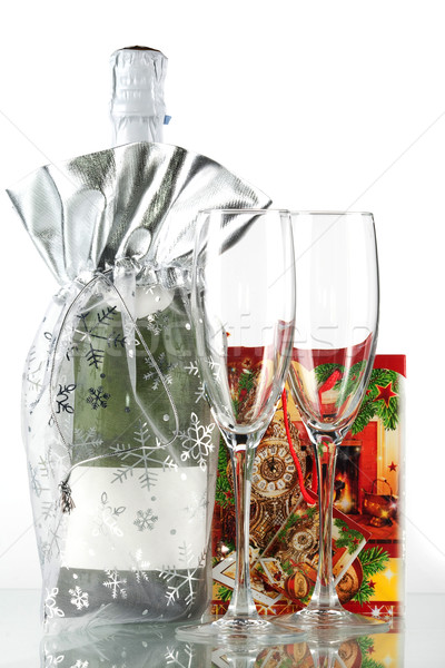 Bottle of champagne, two glasses and small gift Stock photo © karandaev