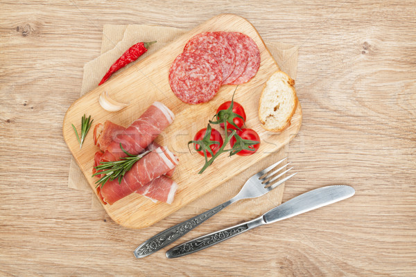Prosciutto, salami, bread, vegetables and spices Stock photo © karandaev
