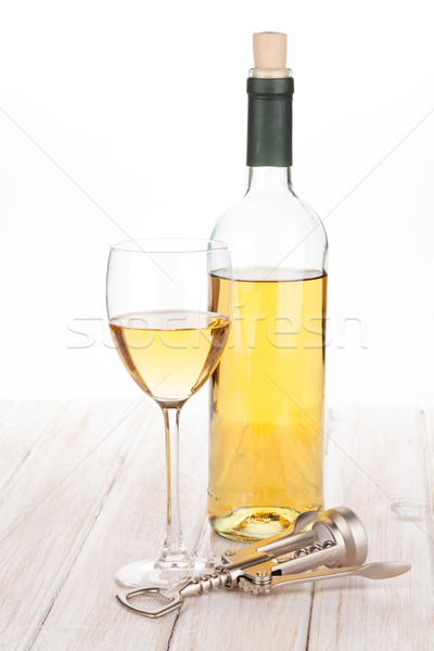 Vino blanco vidrio botella sacacorchos blanco mesa de madera Foto stock © karandaev