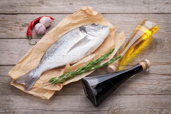 Taze balık pişirme baharatlar ahşap masa Stok fotoğraf © karandaev