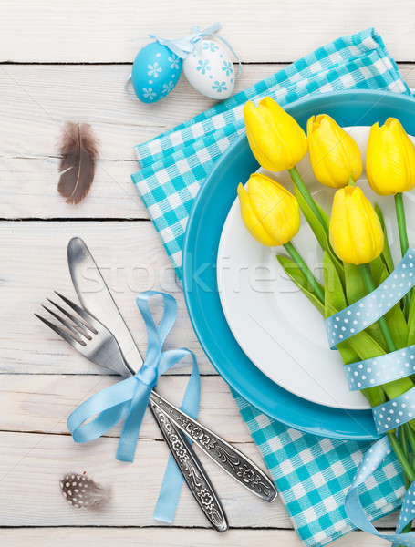 Easter with yellow tulips and colorful eggs Stock photo © karandaev