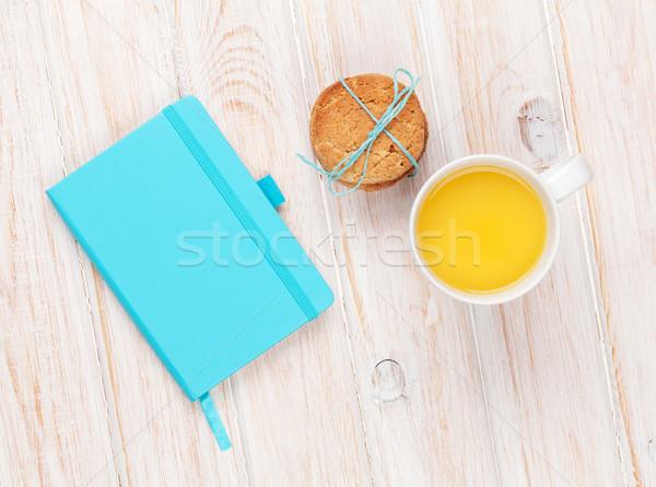 Cup of orange juice, gingerbread cookies and notepad Stock photo © karandaev