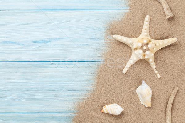 Mar arena estrellas de mar conchas madera mesa de madera Foto stock © karandaev