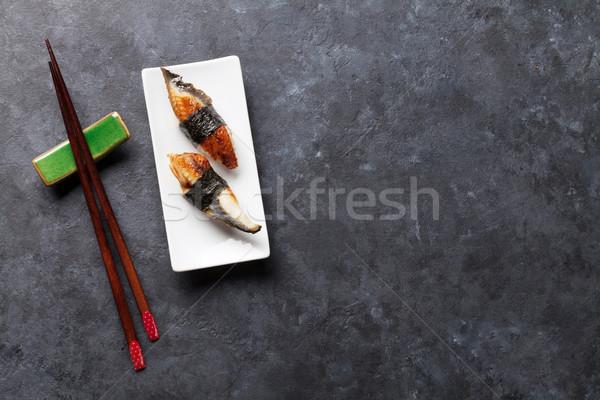 Set of unagi sushi and chopsticks Stock photo © karandaev