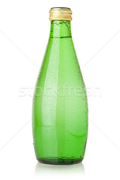 Soda water in glass bottle Stock photo © karandaev