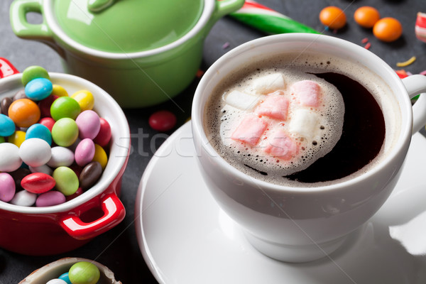 Colorful candies and coffee cup Stock photo © karandaev