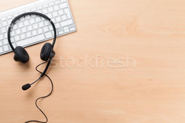 Office desk with headset. Call center support Stock photo © karandaev