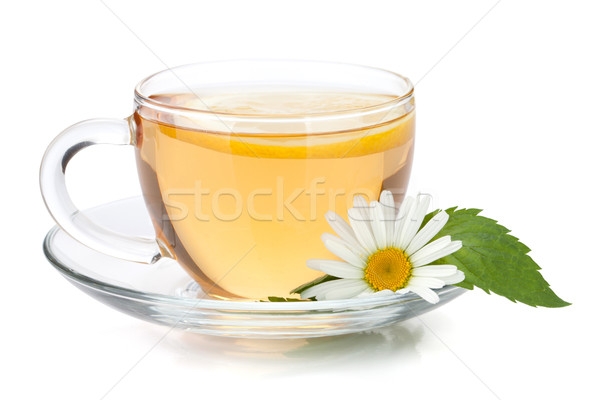Cup of tea with lemon slice, mint leaves and chamomile flower Stock photo © karandaev