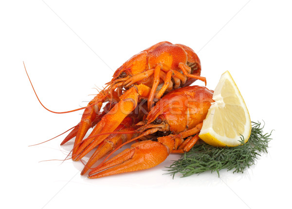 Stock photo: Boiled crayfishes with lemon slice and dill