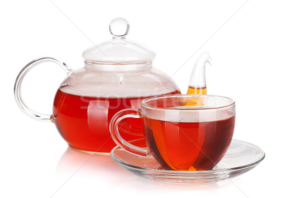 Glass cup and teapot of black tea Stock photo © karandaev