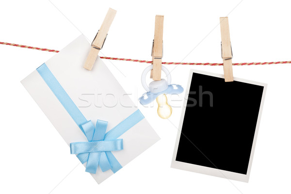 Instant photo, gift letter and pacifier hanging on the clothesli Stock photo © karandaev
