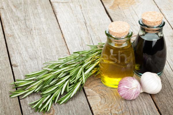 Olio d'oliva aceto bottiglie spezie tavolo in legno legno Foto d'archivio © karandaev