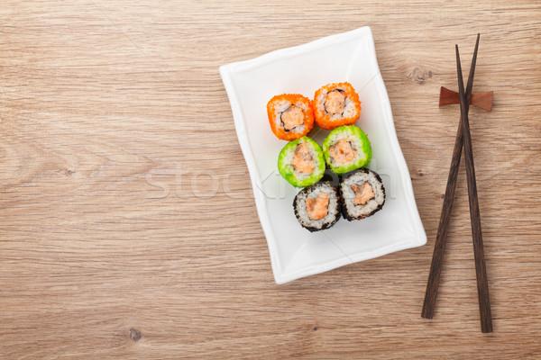 Sushi maki eetstokjes houten tafel exemplaar ruimte Stockfoto © karandaev