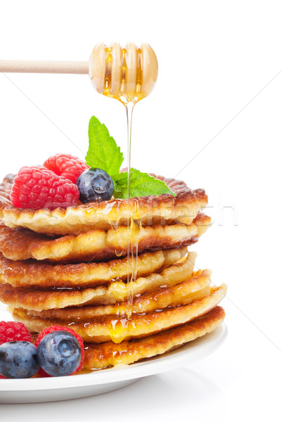 Pancakes with raspberry, blueberry, mint and honey syrup Stock photo © karandaev