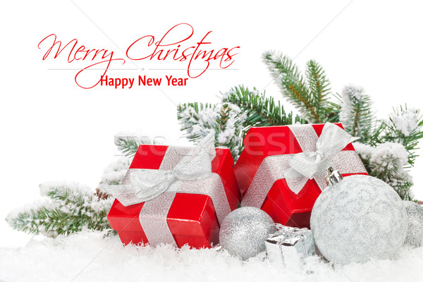 Christmas baubles and red gift boxes with snow fir tree Stock photo © karandaev