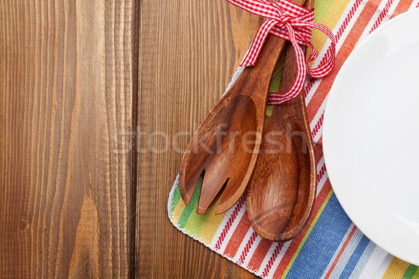 Wood kitchen utensils and empty plate Stock photo © karandaev