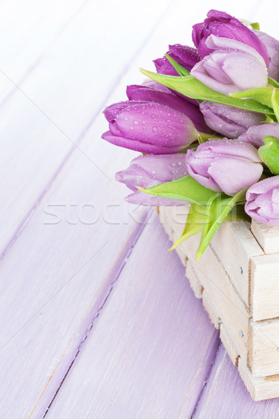 Purple tulips box over wooden table Stock photo © karandaev