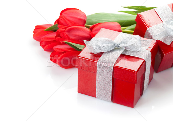 Stock photo: Fresh red tulips with gift boxes