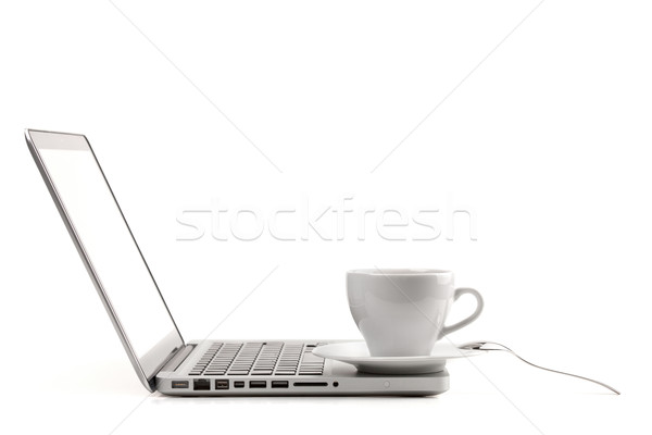 Cappuccino cup with spoon on laptop Stock photo © karandaev