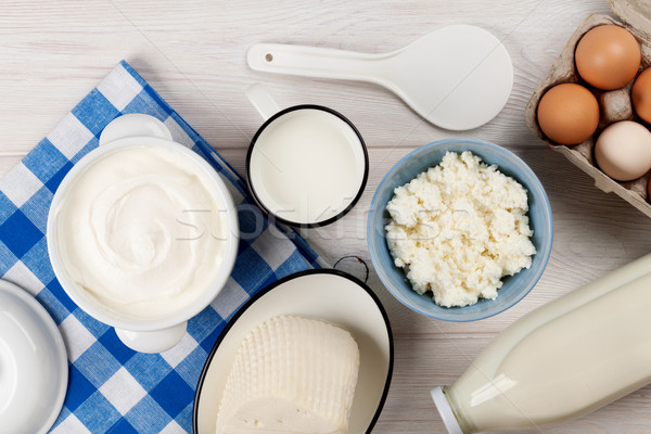 Sour cream, milk, cheese, eggs, yogurt and butter Stock photo © karandaev