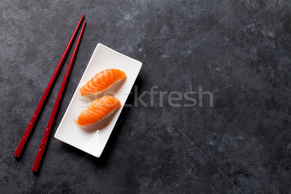 Set of salmon nigiri sushi and chopsticks Stock photo © karandaev