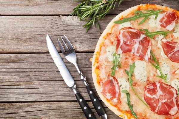 Pizza prosciutto mozzarella ahşap masa üst görmek Stok fotoğraf © karandaev