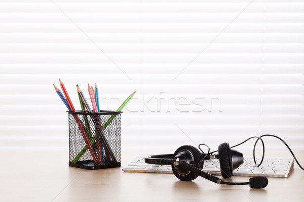 Office desk with headset and pc Stock photo © karandaev