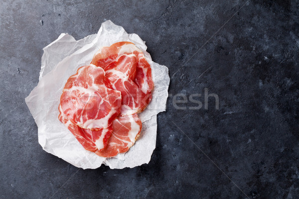 Fatias prosciutto papel pedra topo ver Foto stock © karandaev