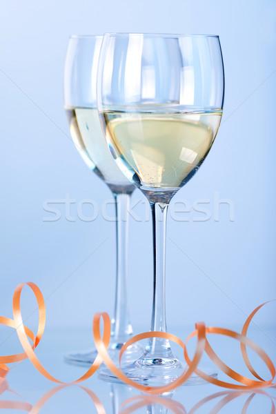 Iki şarap bardakları beyaz şarap mavi gama ışık Stok fotoğraf © karandaev