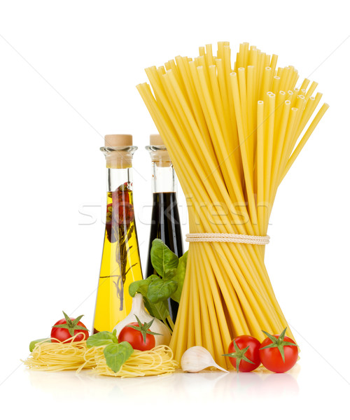 Pasta, tomatoes, basil, olive oil, vinegar, garlic and parmesan  Stock photo © karandaev