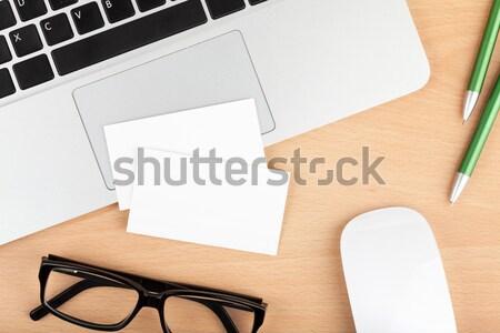 Blank business cards over laptop on office table Stock photo © karandaev