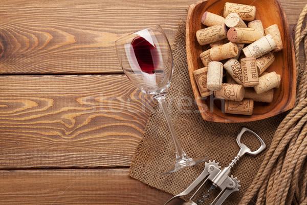 Red wine glass, corks and corkscrew Stock photo © karandaev
