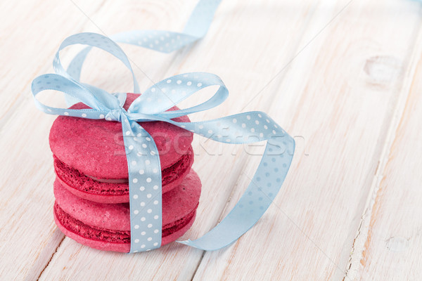Red macarons with blue ribbon Stock photo © karandaev