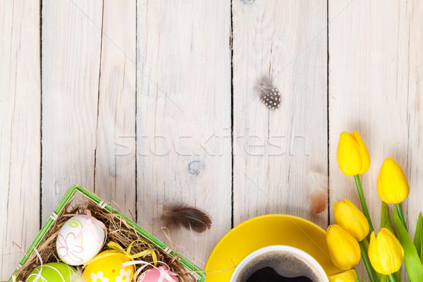 Easter background with colorful eggs and yellow tulips Stock photo © karandaev