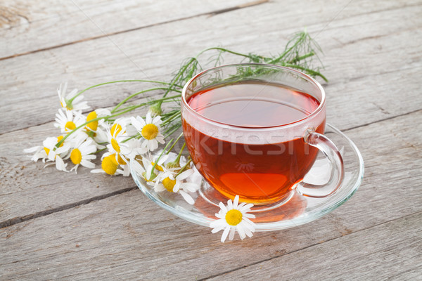 Stock photo: Herbal tea with chamomile flowers