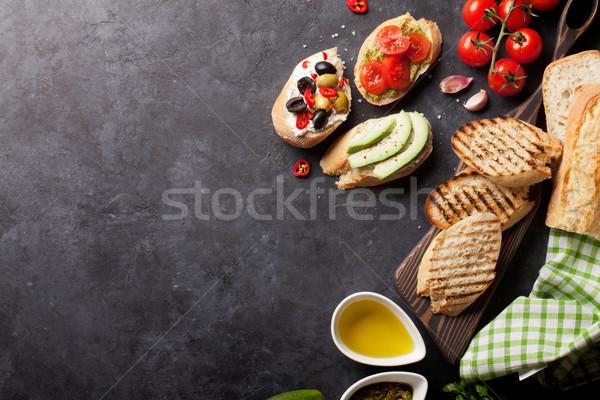 トースト サンドイッチ アボカド トマト オリーブ 石 ストックフォト © karandaev