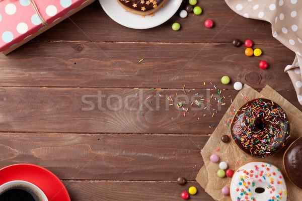 Donut, gift box and coffee Stock photo © karandaev