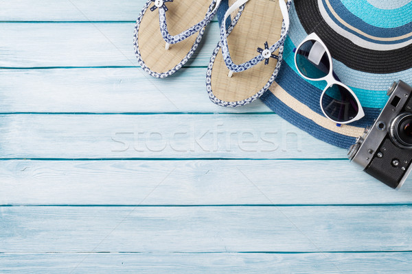 Beach accessories. Flip flops, camera, hat and sunglasses Stock photo © karandaev