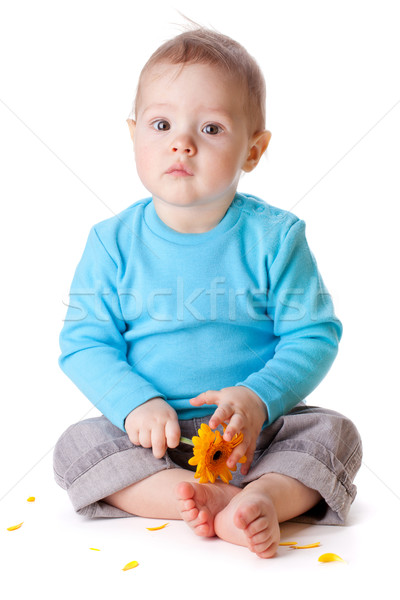 Small baby holding yellow flower Stock photo © karandaev