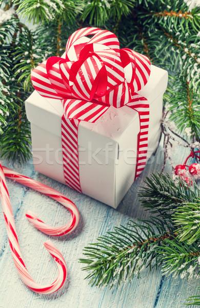 Christmas gift box, candy cane and fir tree Stock photo © karandaev