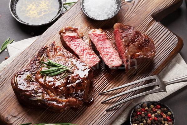 Grilled ribeye beef steak, herbs and spices Stock photo © karandaev