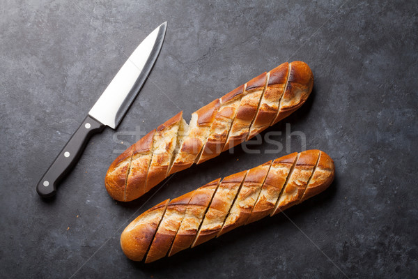 Sliced bread and knife Stock photo © karandaev