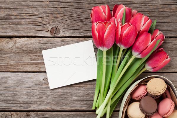 Red tulip flowers and macaroon cookies Stock photo © karandaev