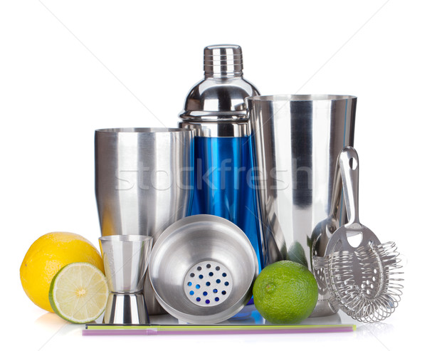 Cocktail shaker, strainer, measuring cup, drinking straws and ci Stock photo © karandaev