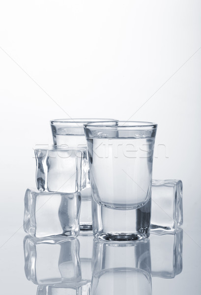 Vodka shots with ice cubes Stock photo © karandaev