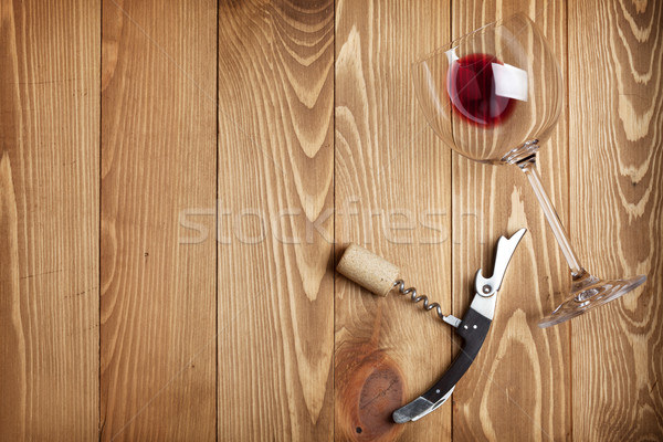 Red wine glass, corkscrew and wine cork Stock photo © karandaev