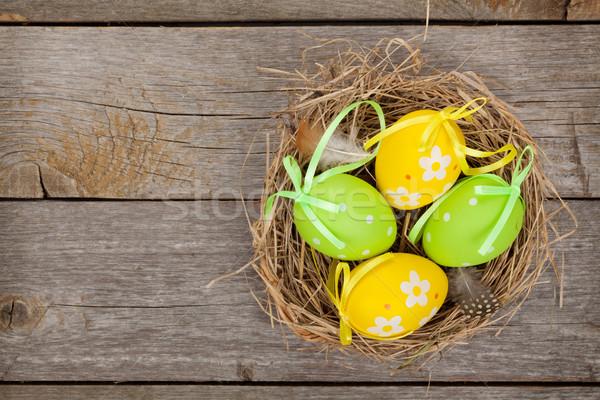 Paskalya yumurtası yuva ahşap masa bo boya arka plan Stok fotoğraf © karandaev